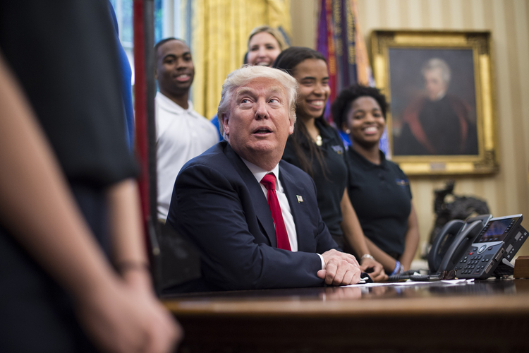 President Donald Trump speaks to students in the Oval Office last Friday. (Jabin Botsford/The Washington Post)/p