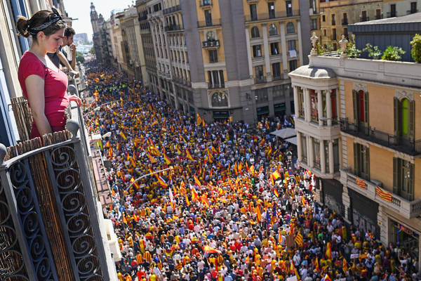 A pro-unity rally marches through Barcelona on Oct. 8 in response to last Sundays disputed referendum on Catalan independence. (Jeff J Mitchell/Getty Images)</p>