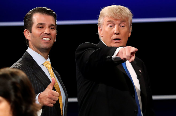 Donald Trump Jr. stands alongside his father after the presidential debate at Hofstra University. (Mike Segar/Reuters)