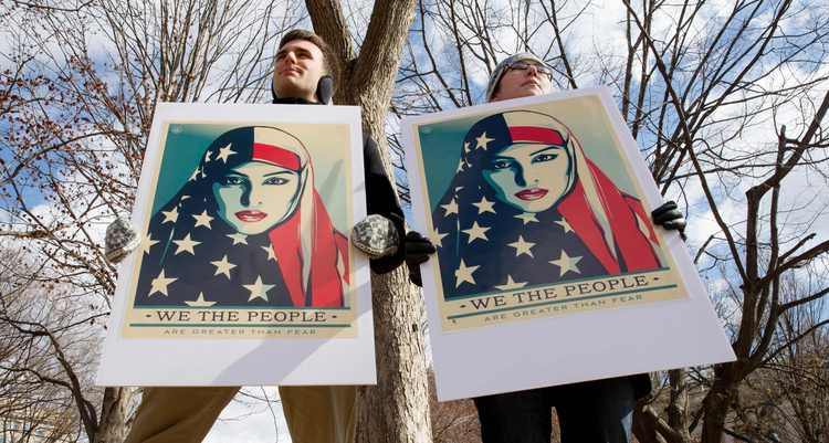 Demonstrators gather outside The White House to protest Trump's new travel ban. (Tasos Katopodis/AFP/Getty Images)/p