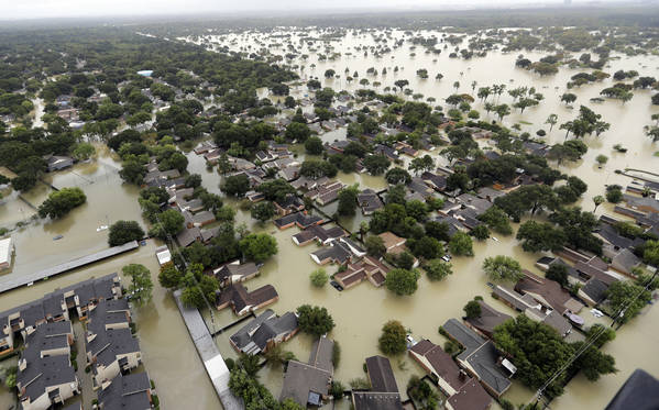 In this file photo, water from the Addicks Reservoir flows into neighborhoods as floodwaters from Tropical Storm Harvey rise in Houston. (AP Photo/David J. Phillip, File)