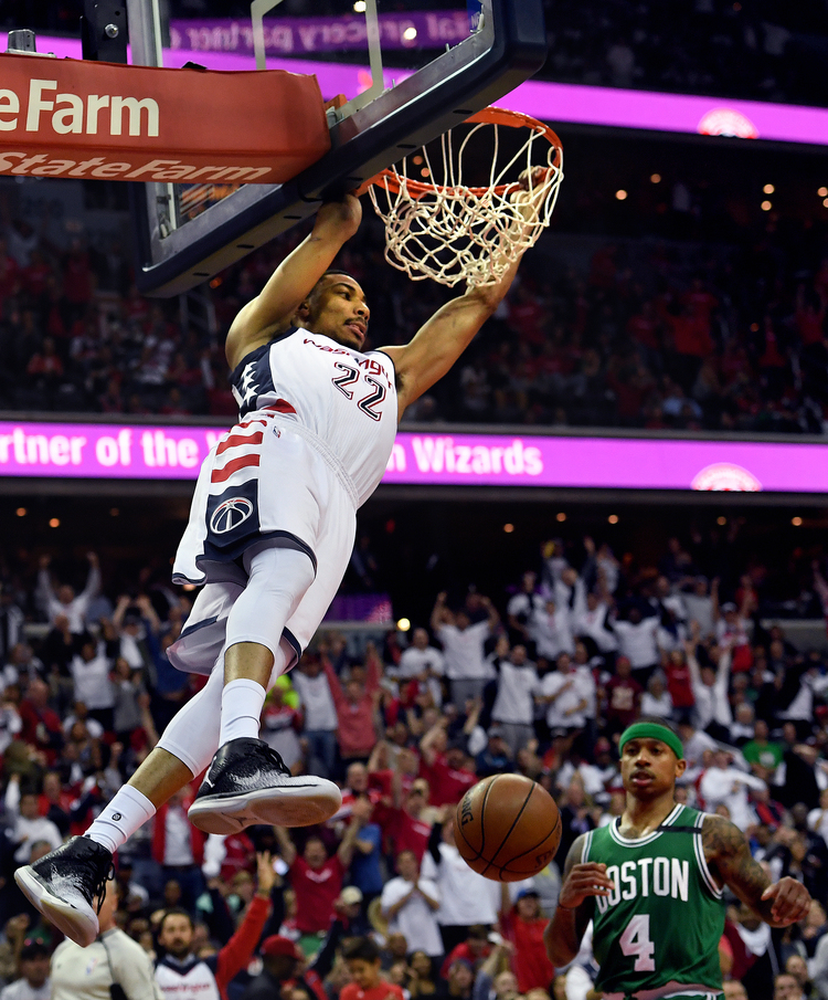 Wizards forward Otto Porter Jr. dunks in front of Isaiah Thomas during the second half of Game Four of the NBA Playoffs Second Round at the Verizon Center last night. (Toni L. Sandys/The Washington Post)/p