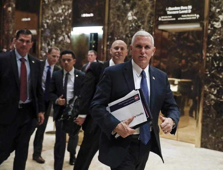 Mike Pence leaves Trump Tower last night. (Carolyn Kaster/AP)</p>