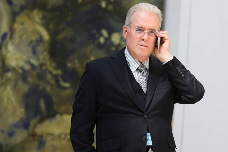 Robert Mercer speaks on the phone during the 12th International Conference on Climate Change. (Oliver Contreras for The Washington Post)