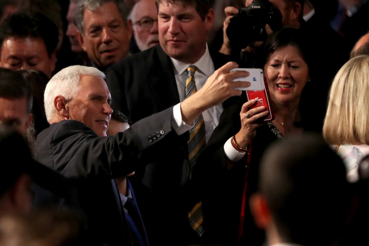 Mike Pence takes&nbsp;a selfie before the debate at Hofstra. He debates Tim Kaine next week. Kaine was campaigning in Florida.&nbsp;(Spencer Platt/Getty Images)</p>