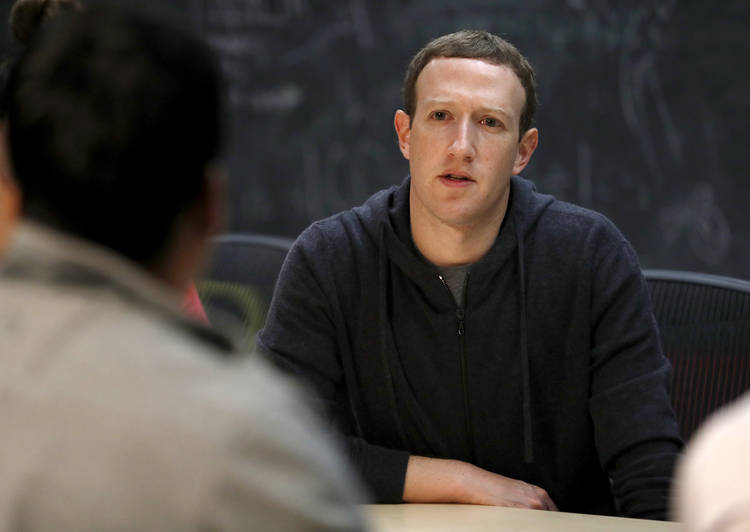 Facebook chief executive Mark Zuckerberg meets with a group of entrepreneurs in St. Louis last November. (Jeff Roberson/AP)