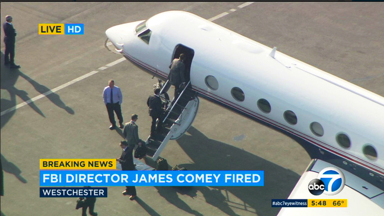 James Comey boards a private jet at Los Angeles International Airport last night after Donald Trump fired him as FBI director. He learned the news on television. (KABC-TV via AP)/p