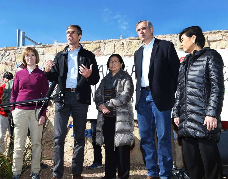 Rep. Beto O'Rourke (D-Tex.) speaks on Saturday alongsidefour other Democratic members of Congress, including Sen. Jeff Merkley (D-Ore.), after touring the Tornillo international port of entry, where several thousand immigrant teens are being housedeast of El Paso. Also there are Sen. Tina Smith (D-Minn.), Sen. Mazie Hirono(D-Hawaii)and Rep. Judy Chu (D-Calif.). (Rudy Gutierrez/El Paso Times/AP)