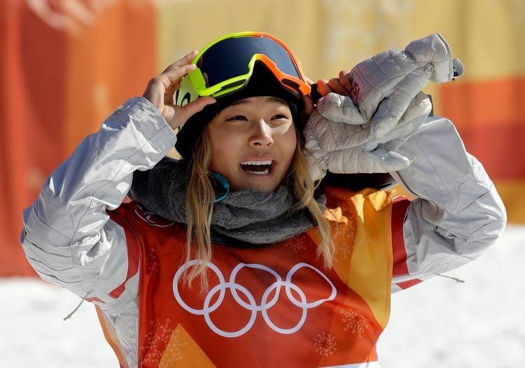 Chloe Kim, of the United States, smiles during the women's halfpipe finals at the 2018 Winter Olympics. (Lee Jin-man/AP)