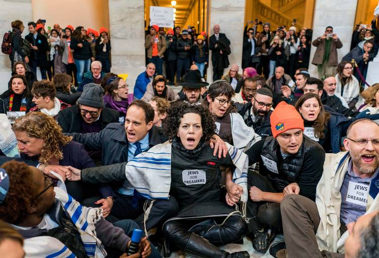 Some 100 Jewish clergy and activists engage in civil disobedience within the Russell Senate Building supporting DACA. (Melina Mara/The Washington Post)