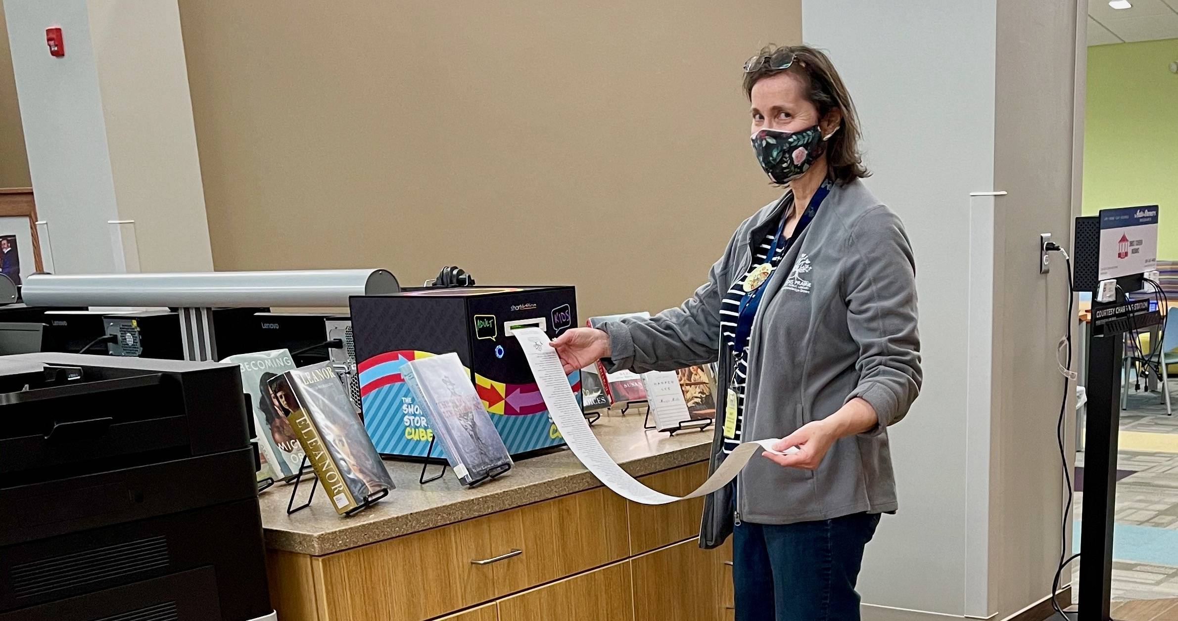 Amy Mientus tries out the Story Cube at the Illinois Prairie District Public Library in Woodford County, Ill. (Courtesy of Joel Shoemaker/Illinois Prairie District Public Library)