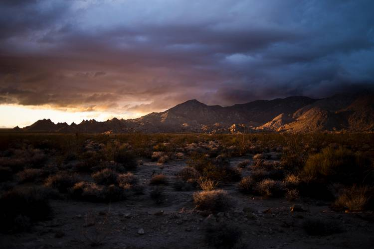 The sun sets last week on the Mojave National Preserve. A bill passed Tuesday by the Senate would connect the preserve with Death Valley National Park. (Jenna Schoenefeld for The Washington Post)
