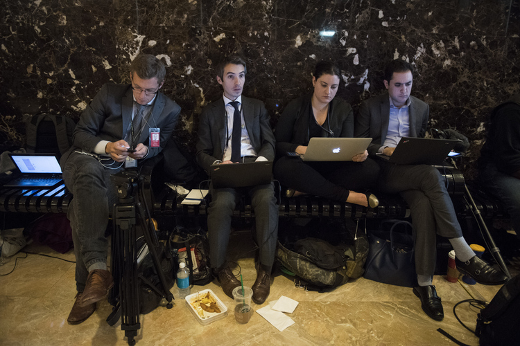 Reporters stake out the lobby of the Trump Tower. (Jabin Botsford/The Washington Post)</p>