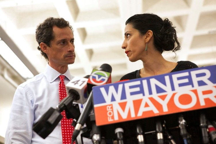 Then-New York mayoral candidate Anthony Weiner and his wife Huma attend a news conference in 2013. (Eric Thayer/Reuters)/p