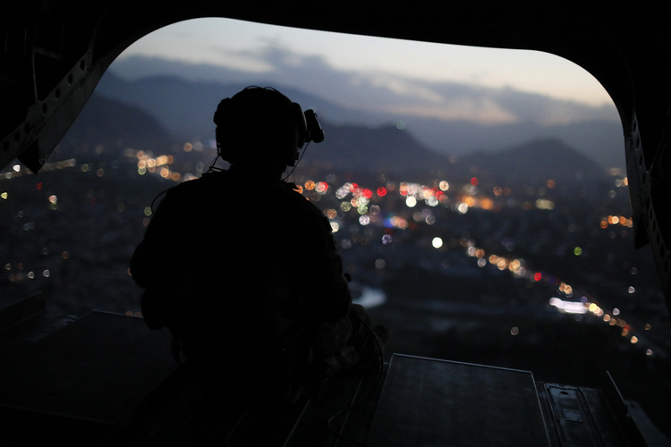 A U.S. Army helicopter crewman manned a gun as James Mattisdeparted Kabul on Monday. (Jonathan Ernst/Pool Photo via AP)/p