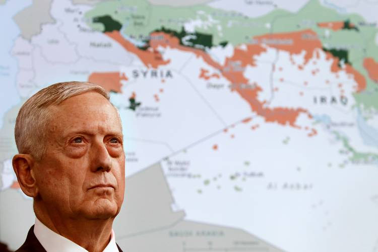 Secretary of Defense Jim Mattis stands in front of a map of Syria and Iraq while speaking to the media about the Islamic State at the Pentagon. (Jacquelyn Martin/AP)