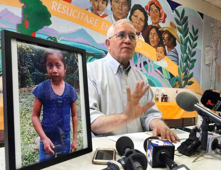 Annunciation House Director Ruben Garcia answers questions from the media after reading a statement from the family of Jakelin Caal Maquin, pictured at left, during a press briefing in El Paso. Jakelin had received her first pair of shoes several weeks ago, when her father said they would set out together for the United States, thousands of miles from her impoverished Guatemalan village. Instead, she died in a Texas hospital after being taken into custody by U.S. Border Patrol agents in a remote stretch of New Mexico desert. (Rudy Gutierrez/El Paso Times/AP)
