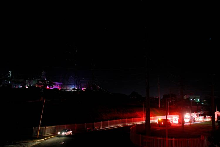 Ambulances at the entrance of an electric substation after an explosion and fire caused a blackout in parts of San Juan. (Ricardo Arduengo/AFP/Getty Images)