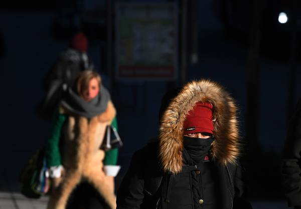 People brave the cold in Arlington, Va., in December 2016. (Matt McClain/The Washington Post)