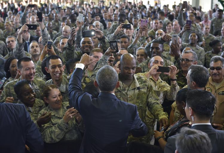 Barack Obama greets service members after speaking at MacDill Air Force Base in Tampa on Tuesday. (Mandel Ngan/AFP/Getty Images)</p>