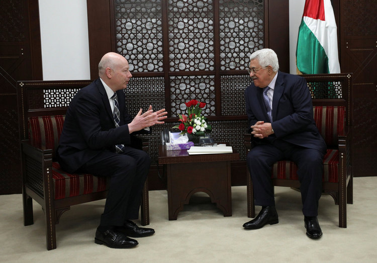 Palestinian President Mahmoud Abbas meets with Jason Greenblatt, Trump's Middle East envoy, in the West Bank city of Ramallah yesterday. (Mohamad Torokman/Reuters)/p