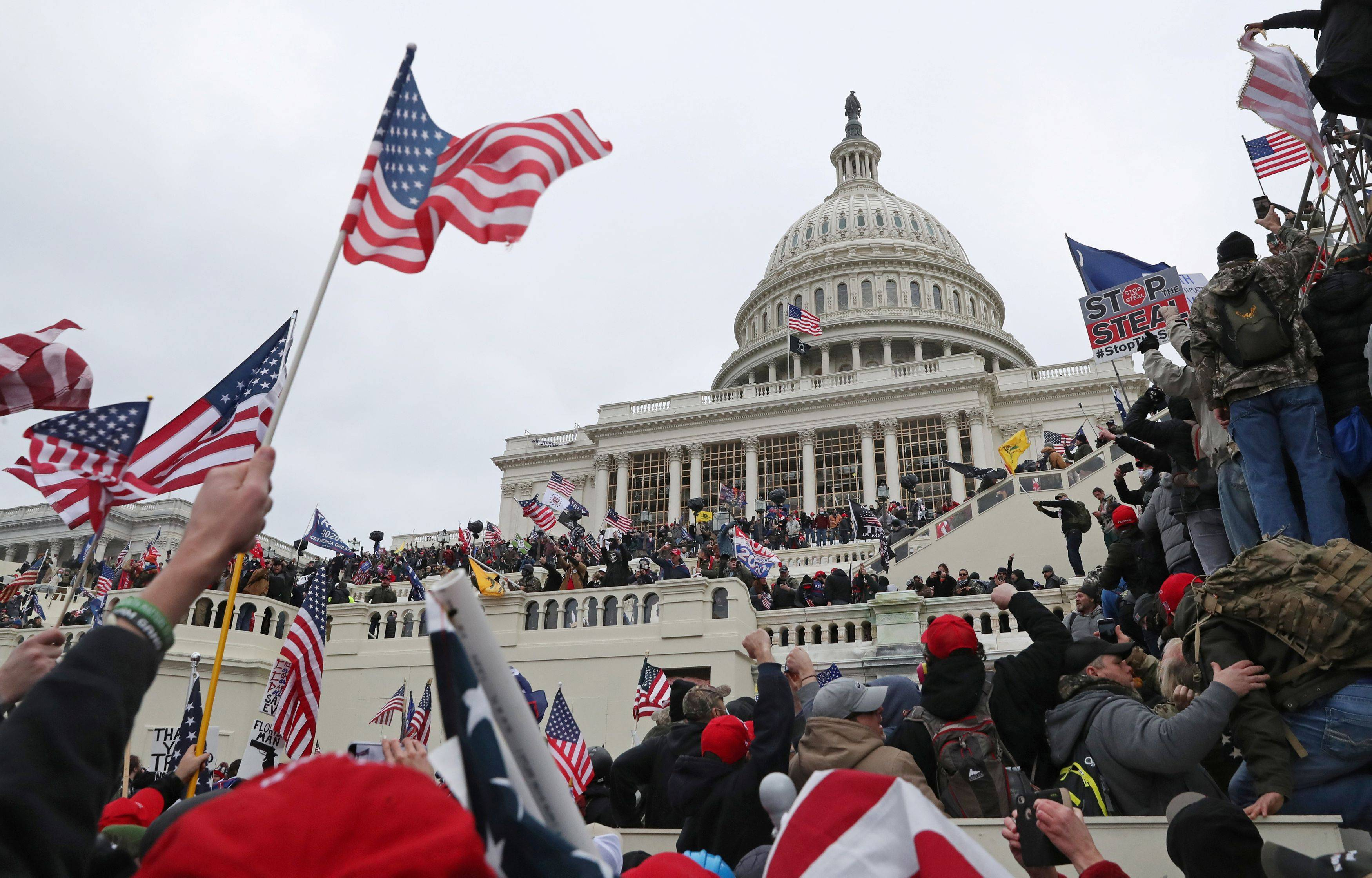 A mob of supporters of President Trump storm the U.S. Capitol in Washington on Jan. 6. (Leah Millis/Reuters)