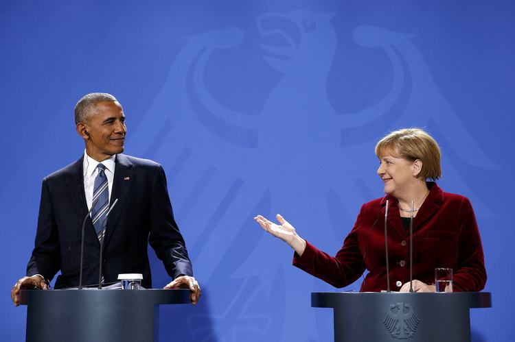 Angela Merkel speaks during a joint news conference with President Obama in Berlin. (Reuters/Fabrizio Bensch)</p>