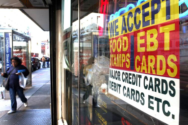 A sign in a market window advertises the acceptance of food stamps in New York. (Spencer Platt/Getty Images)