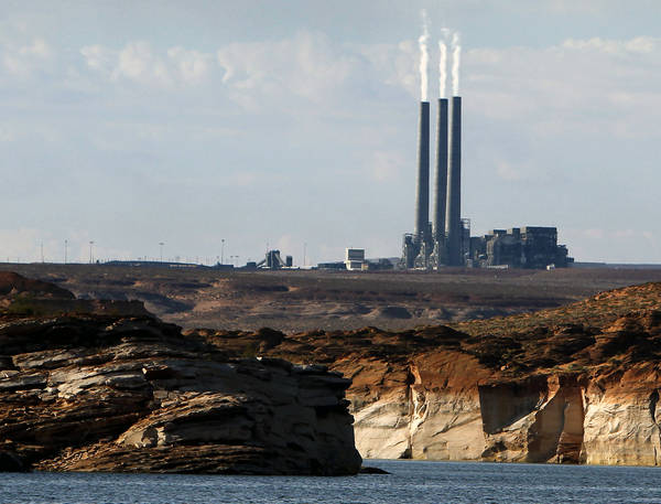 This file photo shows the main plant facility at the Navajo Generating Station, as seen from Lake Powell in Page, Ariz. (AP Photo/Ross D. Franklin, File)