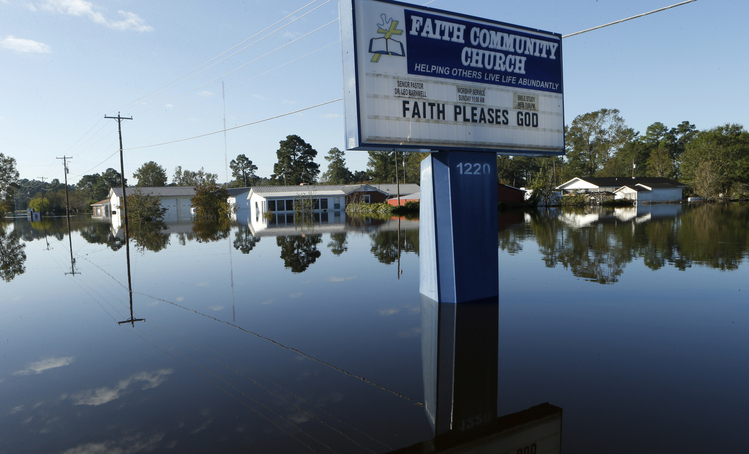 Floodwaters in the aftermath of Hurricane Matthew. (AP Photo/Brian Blanco)/p