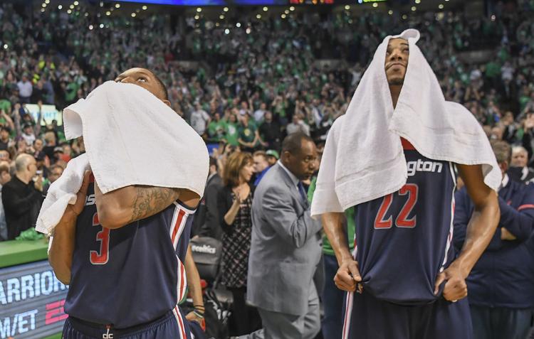 Bradley Beal and Otto Porter Jr. react as their season ends. (Jonathan Newton/The Washington Post)/p