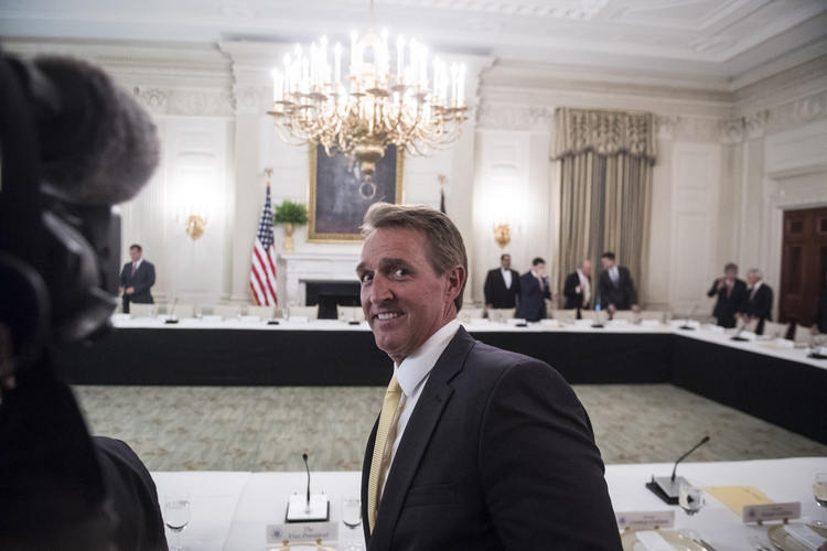 Sen. Jeff Flake (R-Ariz.) arrives at the White House for a Senate GOP luncheon with President Trump about health care last month. (Jabin Botsford/The Washington Post)