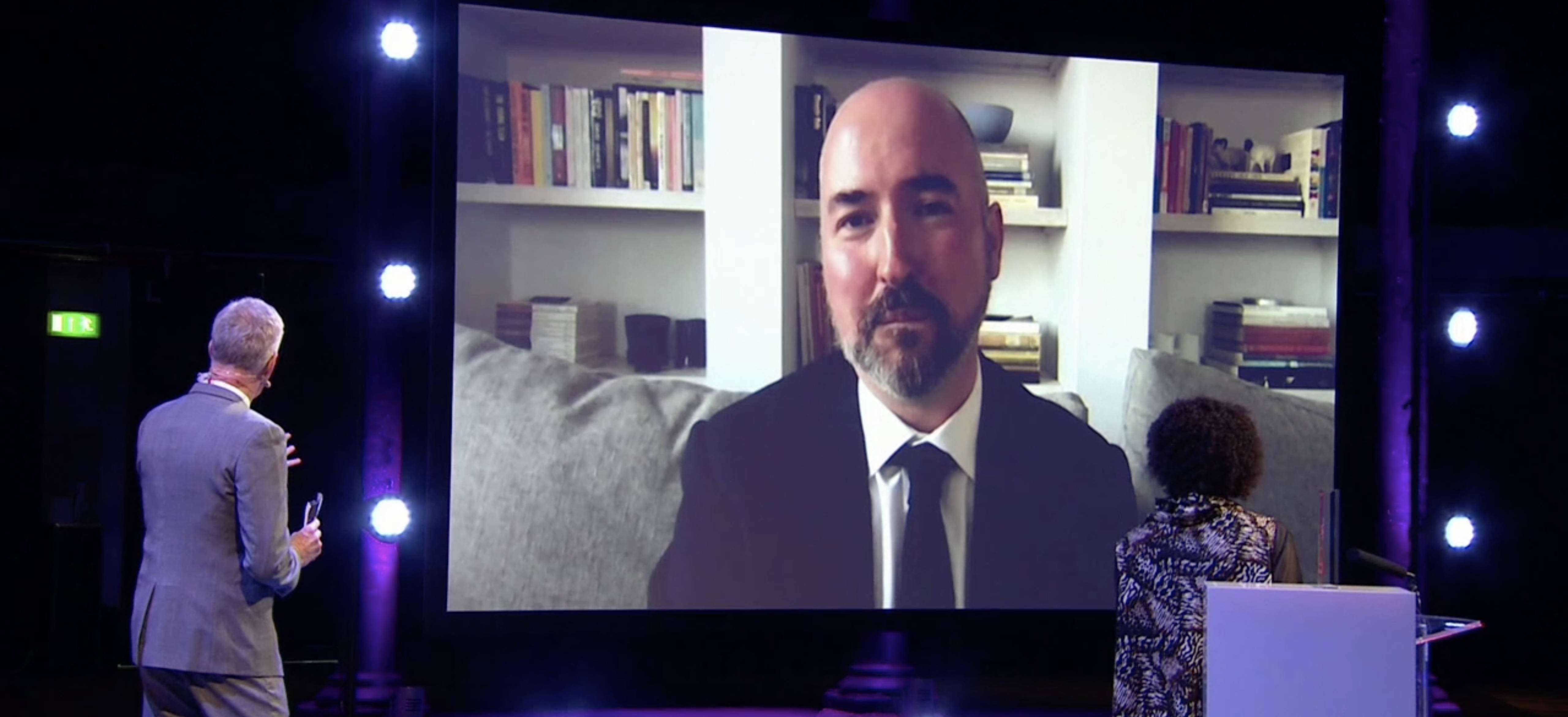 """Douglas Stuart accepts the 2020 Booker Prize for his debut novel, """"Shuggie Bain,"""" during a virtual ceremony streamed by the BBC on Nov. 19, 2020. (Courtesy of BBC)"""