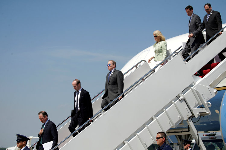 Trump staffers depart from Air Force One together at Joint Base Andrews. (Reuters/Kevin Lamarque)/p