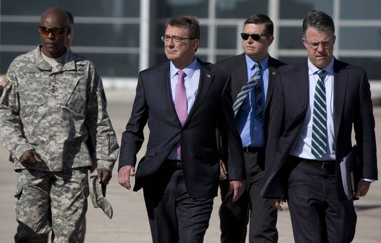 Then-Defense Secretary Ash Carter and his chief of staff Eric Rosenbach (right) leave Jordan for Iraq in 2015. (Carolyn Kaster/Associated Press)