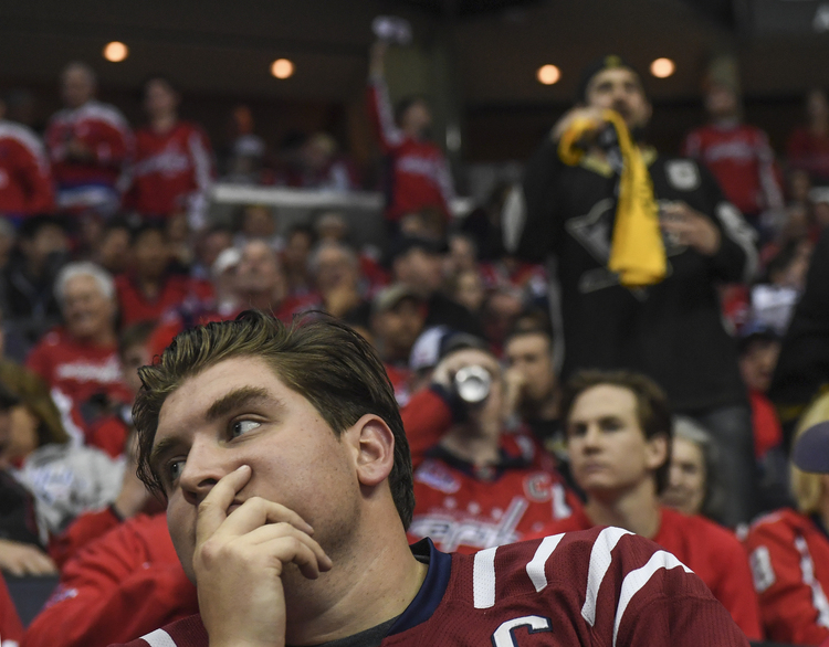 Washington Capitals fan Aaron Foster reacts as his team blows it. They're like Lucy with the football! (Toni L. Sandys/The Washington Post)/p