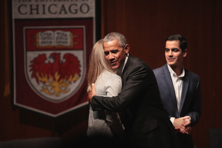 Barack Obama greets youth leaders at the University of Chicago on Tuesday. It was his first formal public appearance since leaving office. (Scott Olson/Getty Images)/p