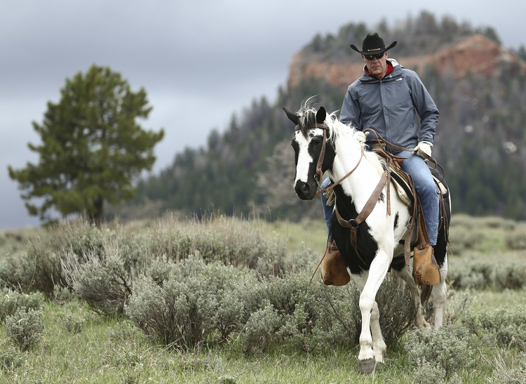 Interior Secretary Ryan Zinke enjoys a horseback ride in the Bears Ears National Monument of Utah last week. (Scott G Winterton/The Deseret News via AP)/p