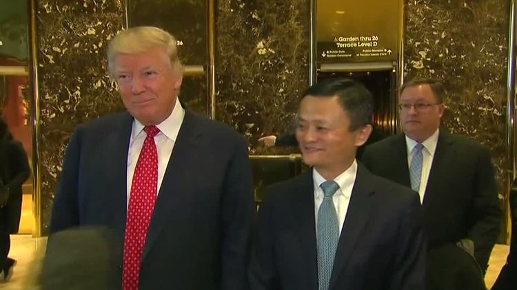 Alibaba founder Jack Ma poses for photos with then President-elect Trump during the transition. (Ryan Brooks)/p