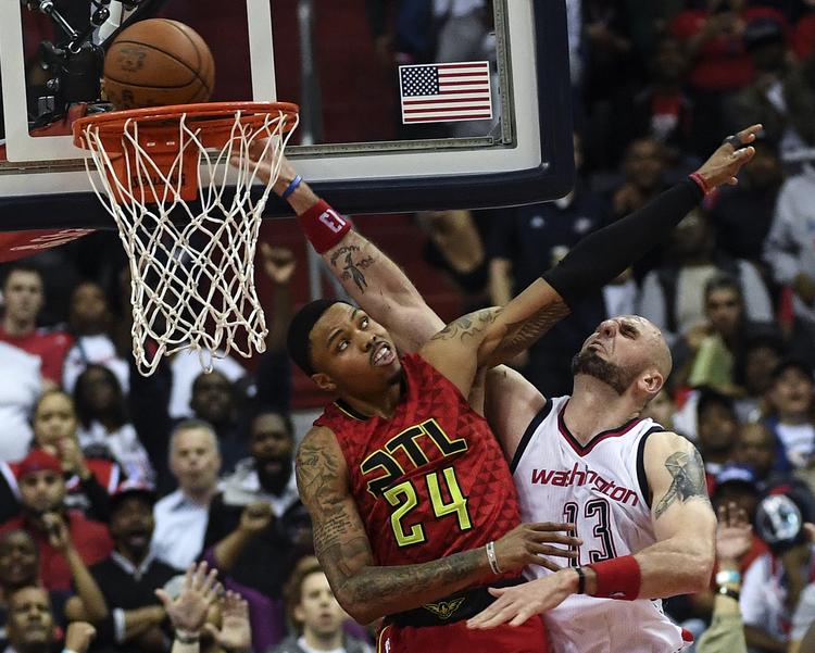 Atlanta Hawks forward Kent Bazemore fouls Washington Wizards center Marcin Gortat during the second half of last night's game at the Verizon Center. (Toni L. Sandys/The Washington Post)/p