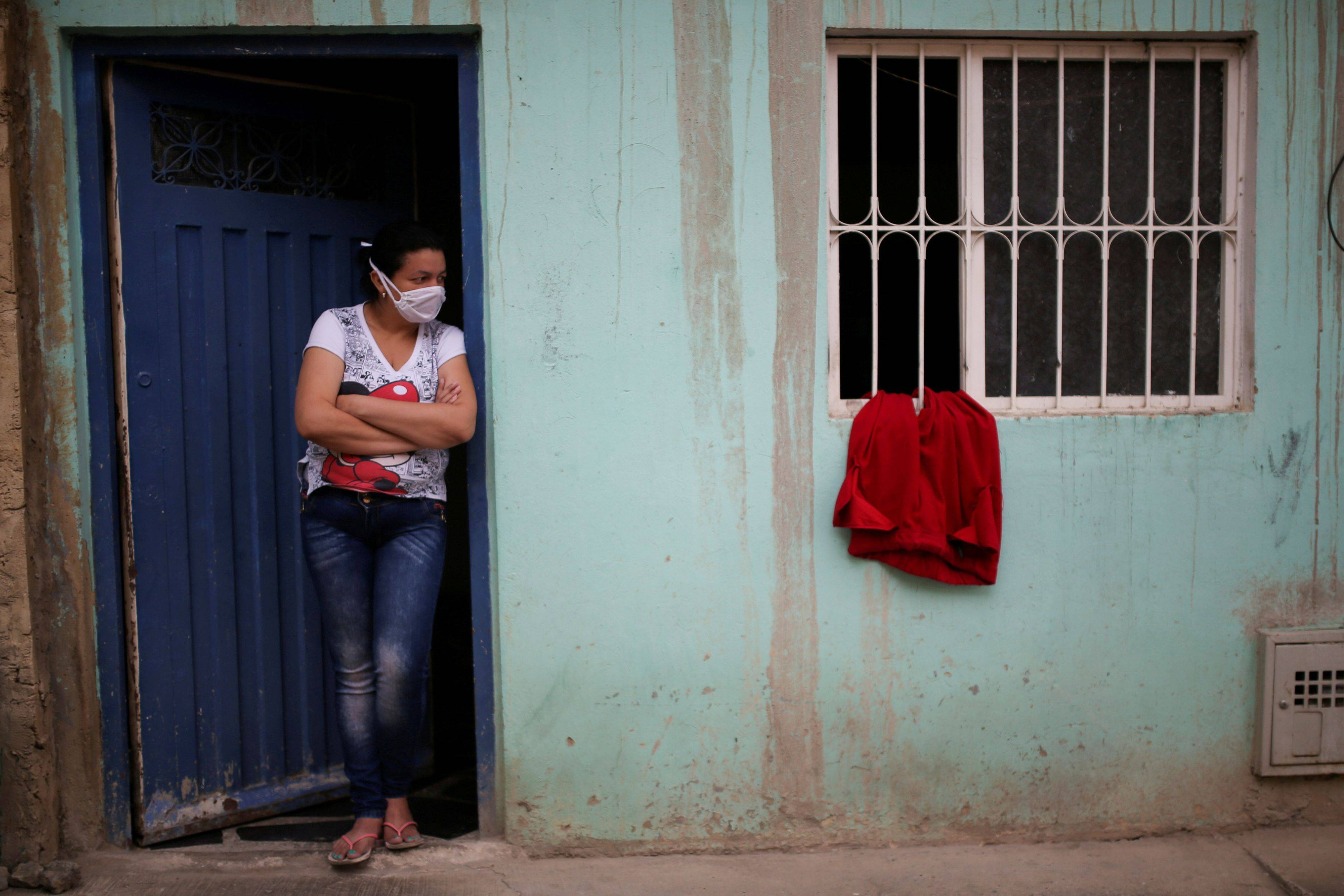 A red cloth hangs in a window April 21 at a home in Bogota, Colombia, where residents have been using them to signal that those in the home are in need of food and government assistance. (Luisa Gonzalez/Reuters)