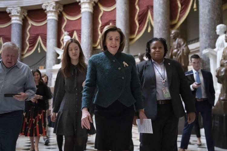 Speaker Nancy Pelosi walks to a meeting at the Capitol last week. (J. Scott Applewhite/AP)