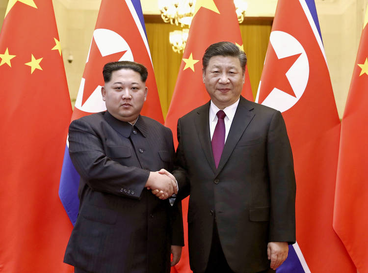 North Korean leader Kim Jong Un and Chinese President Xi Jinping shake hands Wednesday in Beijing. (Ju Peng/Xinhua News Agency/AP)