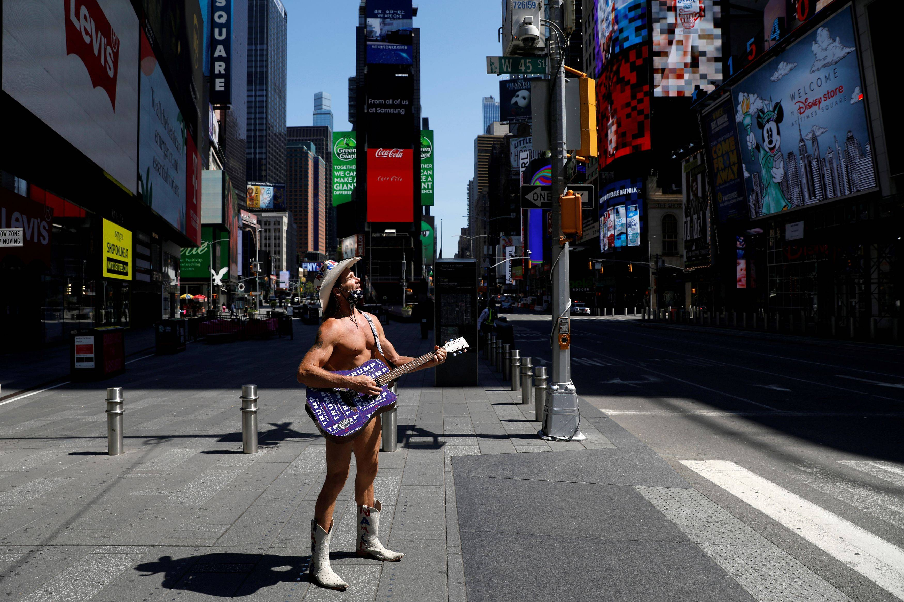 The Naked Cowboy in a nearly empty Times Square last week. (Andrew Kelly/Reuters)