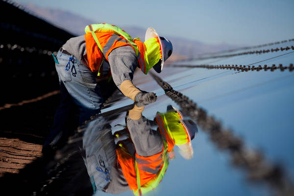 A contractor for First Solar Inc. works on construction of the Tenaska Imperial Solar Energy Center South project in Imperial County, California. (Sam Hodgson/Bloomberg)