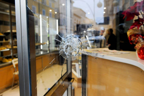 A bullet hole&amp;nbsp;in a shop window&amp;nbsp;in&amp;nbsp;Macerata, Italy, after a spate of&amp;nbsp;drive-by shootings of immigrants there&amp;nbsp;on Feb.&amp;nbsp;3, 2018. (AFP/Getty Images)</p>