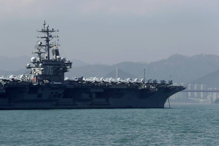 The U.S. Navy's USS Ronald Reagan anchored last week in Hong Kong. (Kin Cheung/AP)