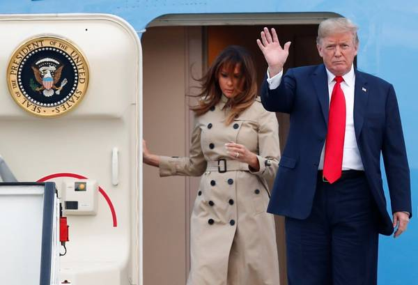U.S. President Donald Trump and first lady Melania Trump arrive aboard Air Force One ahead of the NATO Summit, at Brussels Military Airport in Melsbroek, Belgium, on July 10. (Francois Lenoir/Reuters)