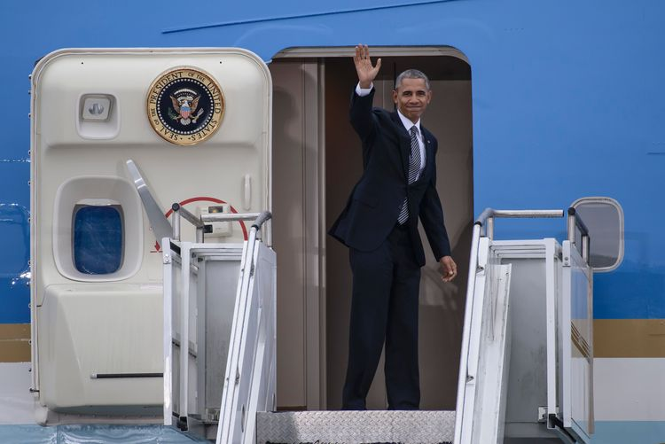 Barack Obama waves as he boards Air Force One in Berlin a few moments ago. (Clemens Bilanc/AFP/Getty Images)</p>