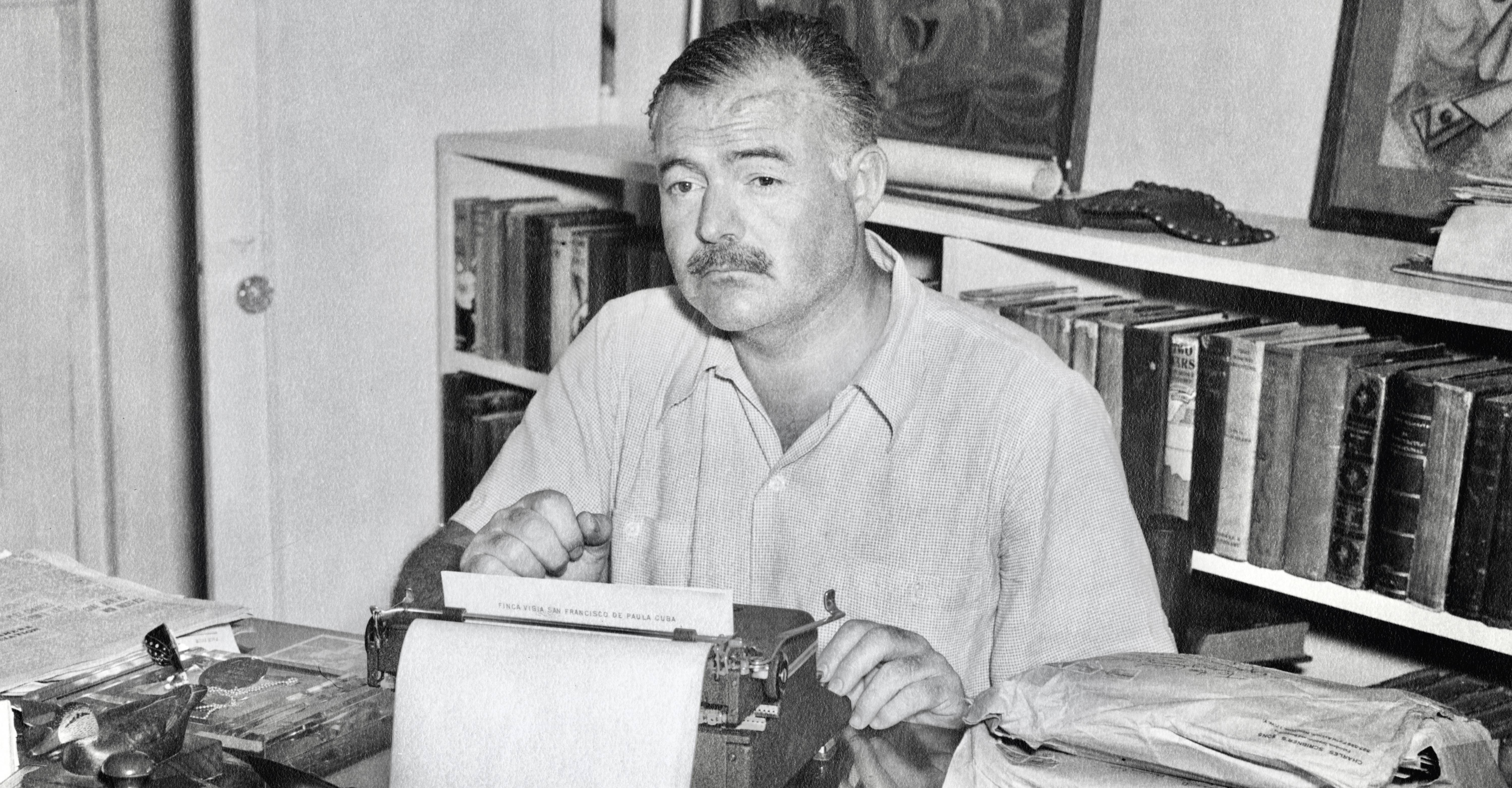 Ernest Hemingway at his desk in Havana, Cuba. (Photographer unknown. Ernest Hemingway Collection. Photographs. John F. Kennedy Presidential Library and Museum, Boston)